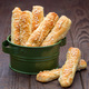 Homemade savory bread sticks with cheese and sesame on wooden ta - PhotoDune Item for Sale
