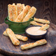 Homemade savory bread sticks with cheese and sesame in a basket, - PhotoDune Item for Sale