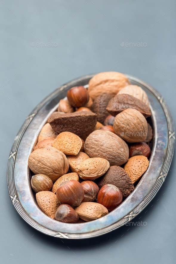 Different kinds of nuts in the shell, hazelnut, walnut, almond a - Stock Photo - Images