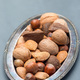 Different kinds of nuts in the shell, hazelnut, walnut, almond a - PhotoDune Item for Sale