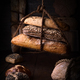 rustic homemade breads tied with ropes on dark wooden stage - PhotoDune Item for Sale