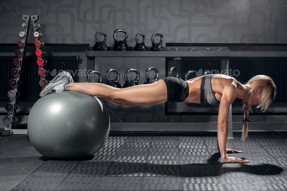 fit blonde female doing exercise with fit ball - Stock Photo - Images