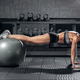 fit blonde female doing exercise with fit ball - PhotoDune Item for Sale