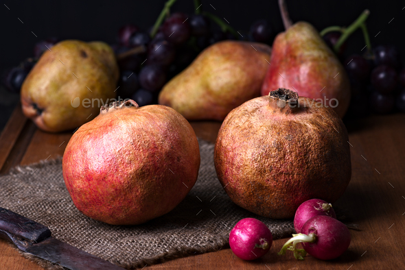 pomegranates and pears with other fruit bodegon with classic light on wood - Stock Photo - Images