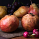 pomegranates and pears with other fruit bodegon with classic light on wood - PhotoDune Item for Sale