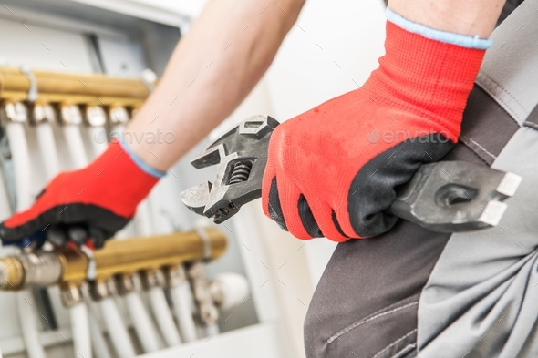 Technician Repairs Heating - Stock Photo - Images