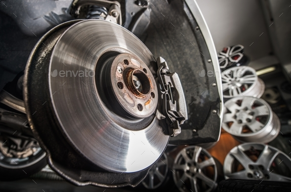 Damaged Brake Disc Replace - Stock Photo - Images