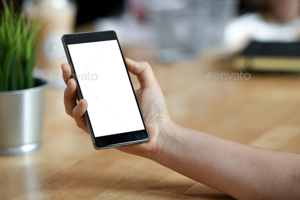 Girl with a blank screen mobile smartphone in her hand. - Stock Photo - Images