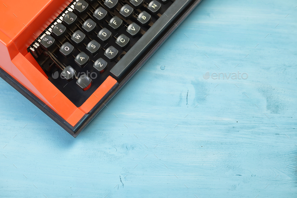Red typewriter keyboard with blue space for text - Stock Photo - Images