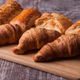 Row of fresh tasty pastry on cutting board - PhotoDune Item for Sale