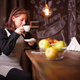 Adult woman enjoys her cup of coffe at bar counter - PhotoDune Item for Sale