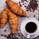 Delicious croissants on vintage wooden table - PhotoDune Item for Sale