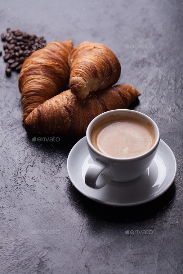Breakfast with freshly baked croissants and cup of coffee - Stock Photo - Images
