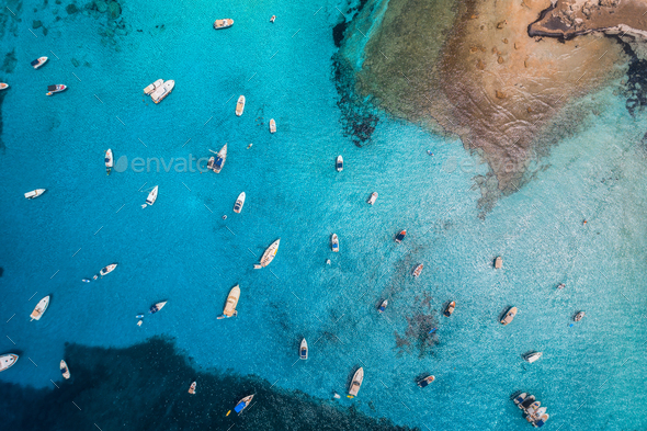 Aerial view of boats and luxury yachts in transparent blue sea - Stock Photo - Images