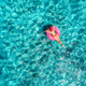 Tropical aerial landscape with girl and azure water - PhotoDune Item for Sale