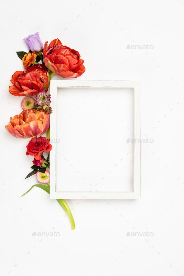 White vintage frame and flowers on a white background - Stock Photo - Images