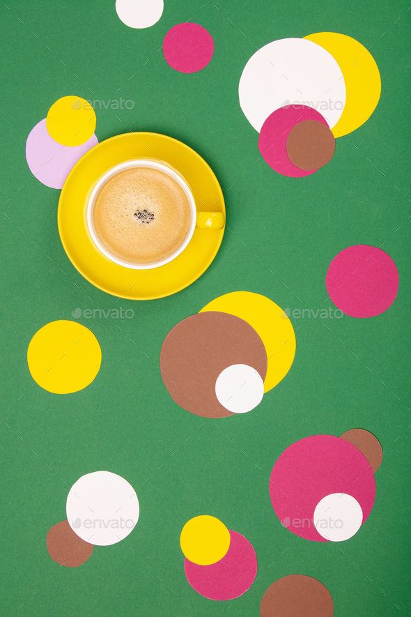 Cup of Coffee and colorful paper circles on green paper backgrou - Stock Photo - Images