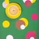 Cup of Coffee and colorful paper circles on green paper backgrou - PhotoDune Item for Sale