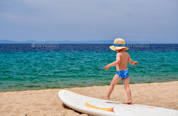 Toddler boy on beach - Stock Photo - Images