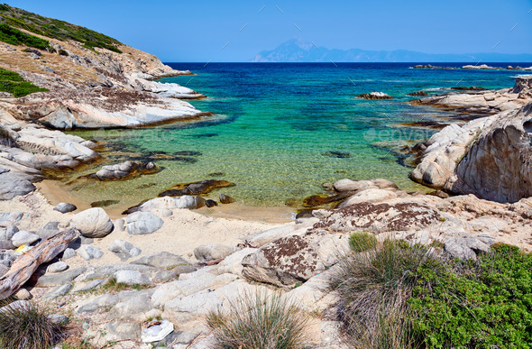 Beautiful beach and rocky coastline landscape in Greece - Stock Photo - Images
