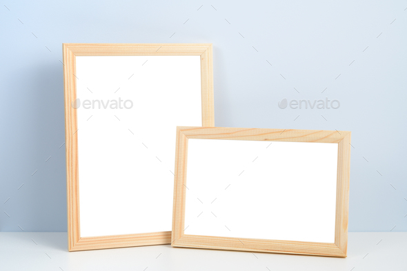 Wooden photo frames standing on shelf - Stock Photo - Images
