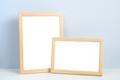 Wooden photo frames standing on shelf - PhotoDune Item for Sale