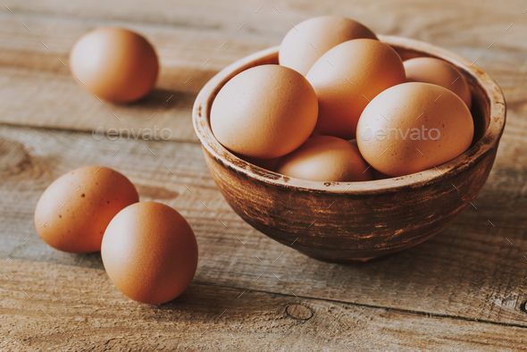 Bowl of raw chicken eggs - Stock Photo - Images