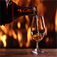 Man's Hand Pours Brandy Into a Glass - VideoHive Item for Sale