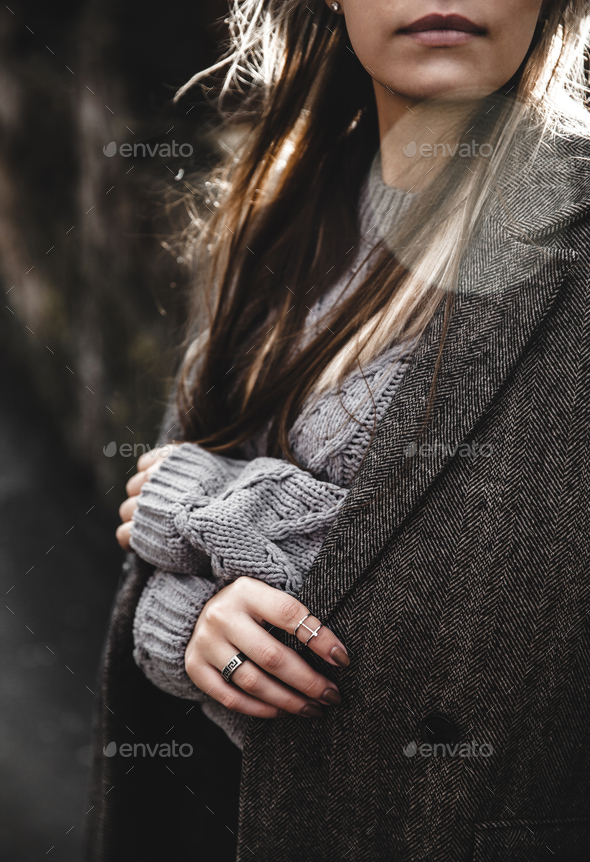 Streetstyle portrait of young woman wearing colorful knitted clothes on the street - Stock Photo - Images