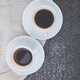 Two white cups of espresso on grey grunge background. - PhotoDune Item for Sale