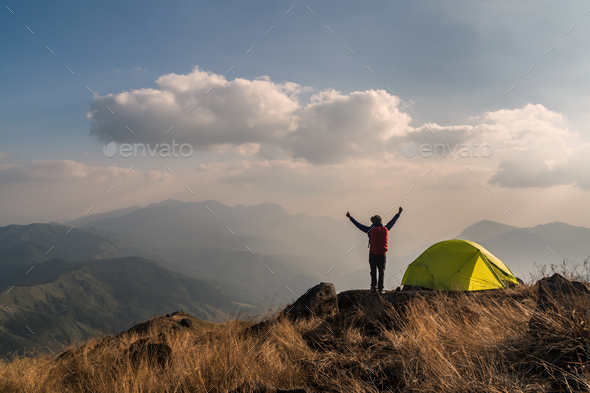 Young man traveler with backpack camping on mountain, Adventure travel lifestyle concept - Stock Photo - Images