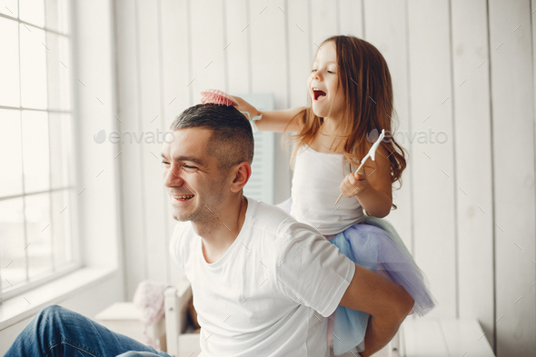 Father playing with a little daughter - Stock Photo - Images