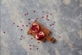 Stop motion animation moving grains of pomegranate and two halves of ripe juicy fruit on a gray - PhotoDune Item for Sale