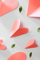 Greeting patter with valentines hearts in a color of the year 2019 Living Coral pantone on a white - PhotoDune Item for Sale