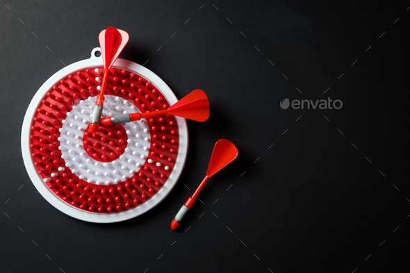Dartboard with three dart arrows - Stock Photo - Images