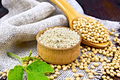 Flour soy in bowl with soybeans on dark board - PhotoDune Item for Sale