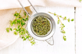 Thyme dry in strainer on board top - PhotoDune Item for Sale