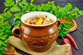 Roast meat and potatoes in pot on dark board - PhotoDune Item for Sale