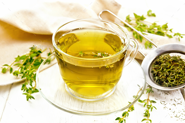 Tea of thyme in cup on light board - Stock Photo - Images