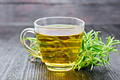 Tea of rosemary in cup on dark board - PhotoDune Item for Sale