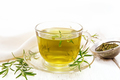 Tea of rosemary in cup with napkin on board - PhotoDune Item for Sale