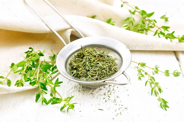 Thyme dry in strainer on board - Stock Photo - Images