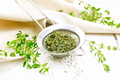 Thyme dry in strainer on board - PhotoDune Item for Sale