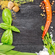 Frame from herbs and pepper on black board - PhotoDune Item for Sale