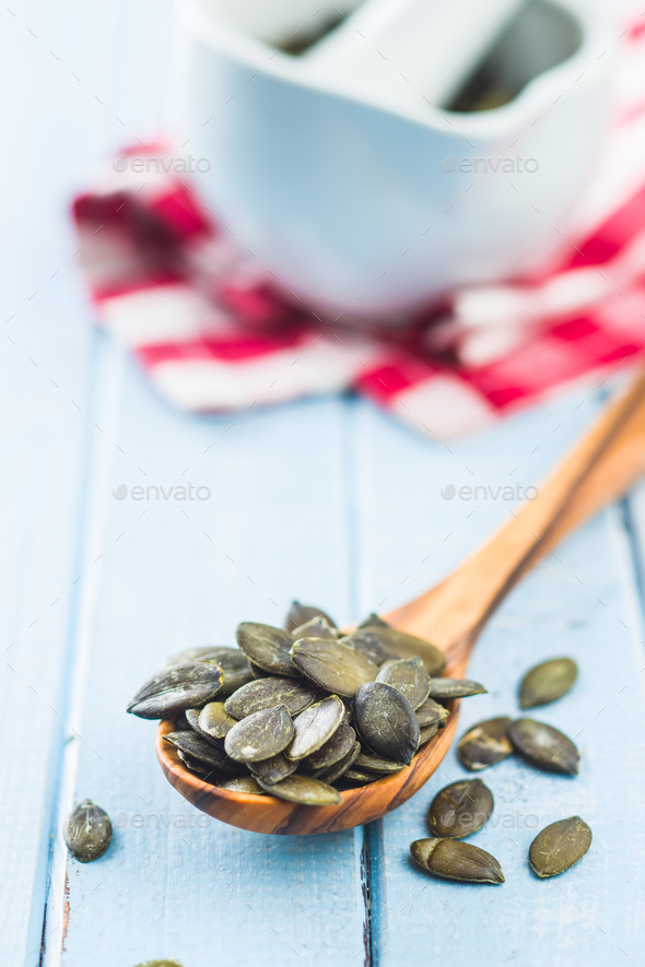 Peeled pumpkin seeds. - Stock Photo - Images