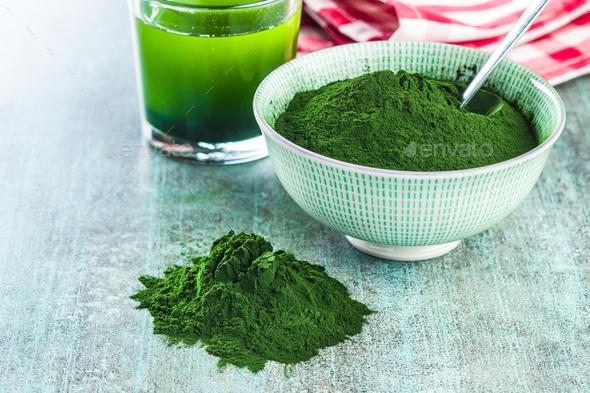 Chlorella or green barley. Detox superfood. - Stock Photo - Images