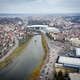 Aerial above view of river crossing the city. Drone shot of Cluj Napoca, Romania - PhotoDune Item for Sale