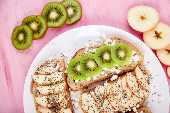 Healthy breakfast toasts with kiwi, apple, cottage cheese and chia seeds - Stock Photo - Images