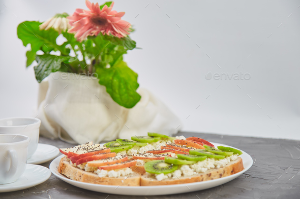 Healthy breakfast coffee, bouquet of flower and toasts - Stock Photo - Images
