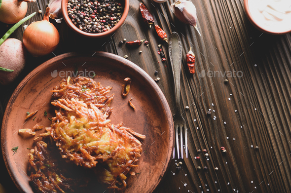 Top view Fresh homemade tasty potato pancakes in clay dish with - Stock Photo - Images